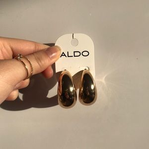 Aldo really cute thick gold hoops.